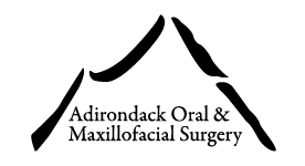ADK Oral and Maxo Logo